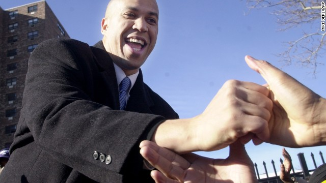 Newark City Councilman Cory Booker reaches out to supporters as he declares his candidacy for mayor in Newark, N.J., Tuesday, Jan. 8, 2002. Booker, 32, a Yale Law School graduate and freshman councilman who moved to Newark in 1997, has criticized four-term Newark Mayor Sharpe James for focusing on big building projects, charging that neighborhoods have been shortchanged.