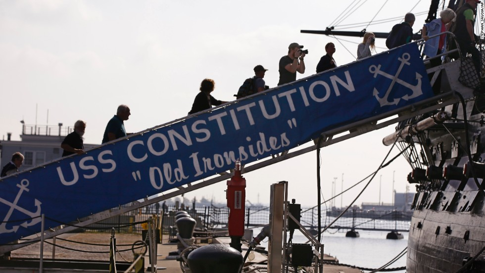 Visitors to the U.S.S. Constitution walk up the gangplank for a tour in Boston on October 17.