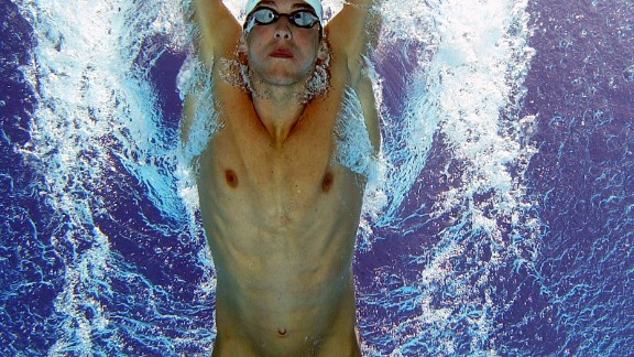 Micahel Phelps wearing a Speedo Fastskin swimming suit during the 2004 Olympics.