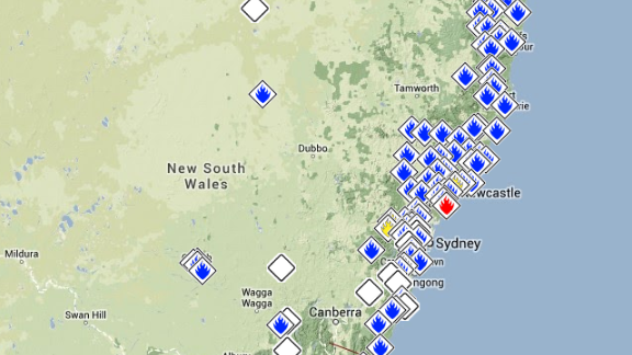 Nearly 100 fires burned across New South Wales on October 18.