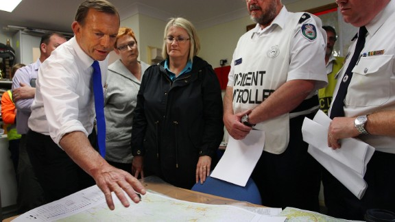 Australian Prime Minister Tony Abbott speaks during a bush fire briefing in Winmalee on October 18.