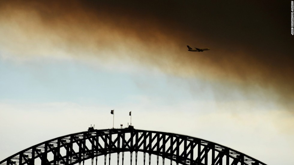 Smoke fills the sky over the Sydney Harbour Bridge on October 17.