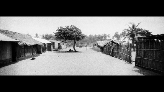"""Called """"Under the Village Tree,"""" this photograph is from a series called """"Galamse,"""" which is about the relationship between Ghanaians and their land."""