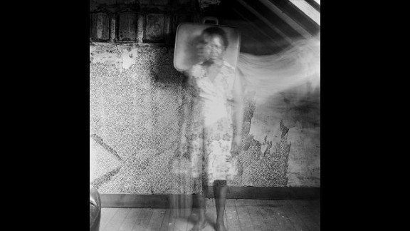 In the photographs she tries to demonstrate that she doesn't feel at home anywhere and that she is unable to settle down.
