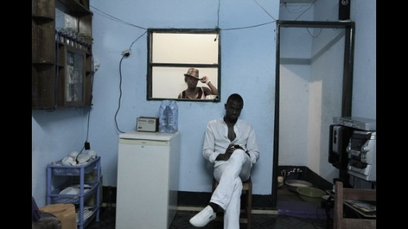 """This photograph, called """"Be the Me,"""" was taken in a restaurant in Yaounde, Cameroon, while Okereke was on the """"Invisible Borders Road Trip 2012,"""" from Lagos to Libreville in Gabon."""