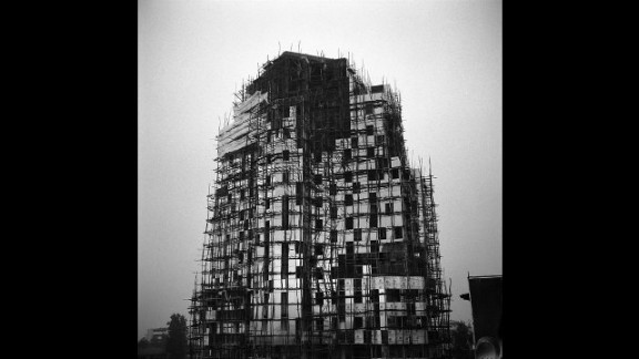 """An image by Ethiopian photographer Michael Tsegaye, from the series """"Future Memories."""" It depicts a new office building under construction in Addis Ababa."""