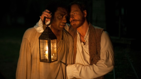 """Chiwetel Ejiofor, left, stars as Solomon Northup and Michael Fassbender stars as Edwin Epps in """"12 Years a Slave."""""""