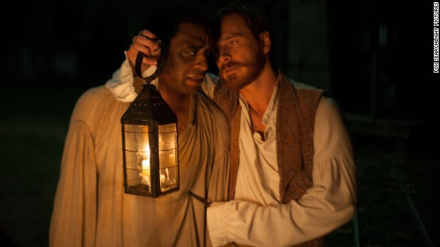 "Chiwetel Ejiofor stars as Solomon Northup and Michael Fassbender stars as Edwin Epps in ""12 Years a Slave."""