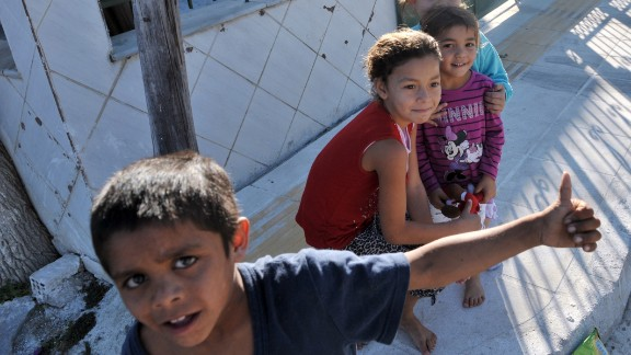 Children play in a Roma settlement in Farsala, Greece, where the