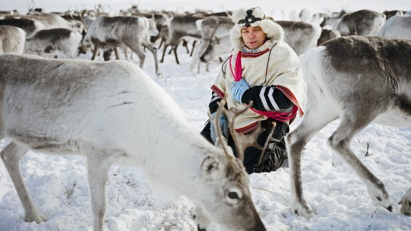 """The photographs are part of a National Geographic exhibition called """"Women of Vision,"""" featuring 11 female photojournalists. Here, a herder in Norway practices a time-honored custom called yoiking -- chanting softly while tending his reindeer."""