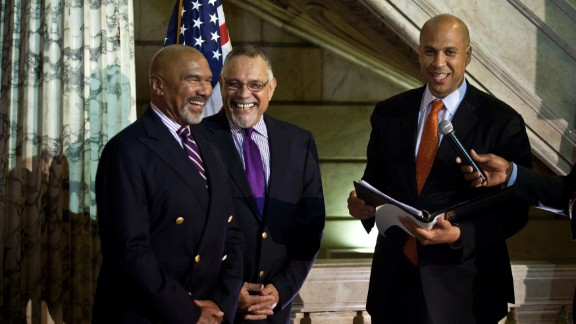 On October 21, 2013, Cory Booker, right, officiates a wedding ceremony for Joseph Panessidi, center, and Orville Bell at the Newark, New Jersey, City Hall. The New Jersey Supreme Court denied the state