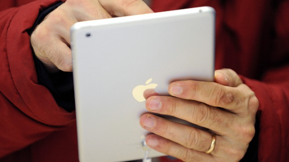 A man uses a iPad Mini, which was released by Apple on November 2, 2012. Here