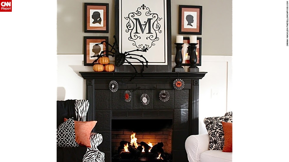 "This fireplace is a spooky and inviting Halloween display. <a href=""http://ireport.cnn.com/docs/DOC-1051059"">Sarah Macklem</a> dressed it with a little elegance and edginess. You can see more of her designs on her blog, <a href=""http://www.theyellowcapecod.com"" target=""_blank"">The Yellow Cape Cod</a>."
