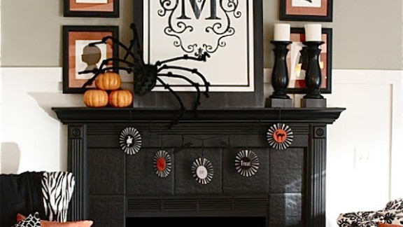 This fireplace is a spooky and inviting Halloween display. Sarah Macklem dressed it with a little elegance and edginess. You can see more of her designs on her blog, The Yellow Cape Cod.