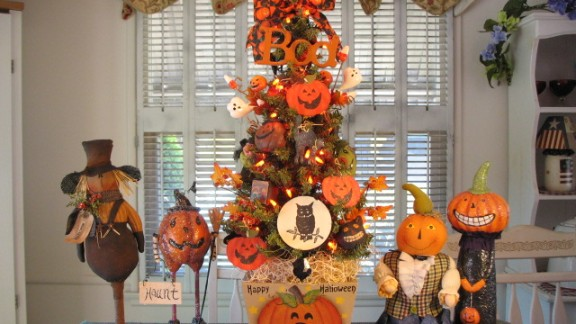 Denise Guillen wanted an early start for Christmas this year, so she decorated small trees around her home in a Halloween style.