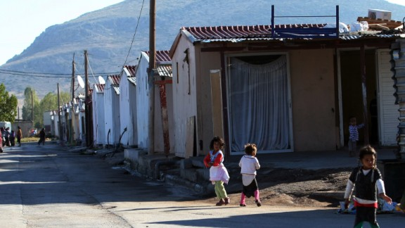 """Roma children play next to a Roma settlement in Farsala, Greece, on Saturday, October 19. Haralambos Dimitriou, head of the local Roma community, said Dimopoulou and Salis raised Maria like a """"normal"""" child."""