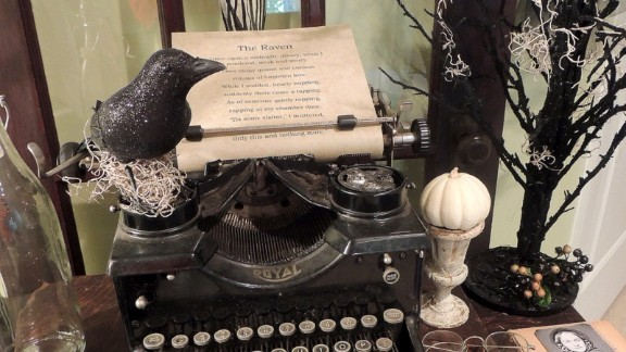 In this close-up, you can see a raven perched atop the typewriter, and a picture of Poe and his lost love. Hartzog's blog, The Refeathered Roost, shows more.