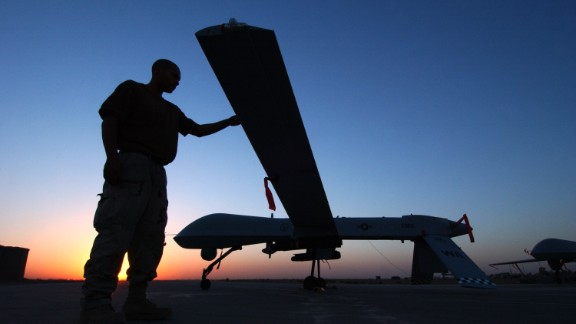 A crew chief from the 46th Expeditionary Reconnaissance Squadron completes a post flight inspections of the RQ-1 Predator after one of its sorties September 15, 2004 in Balad Air Base, Iraq.