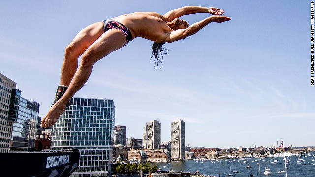 In this handout image provided by Red Bull, Orlando Duque of Colombia dives from the 27.5 metre platform on the ICA building at Fan Pier during the fifth stop of the Red Bull Cliff Diving World Series on August 25, 2013 in Boston, Massachusetts. (Photo by Dean Treml/Red Bull via Getty Images