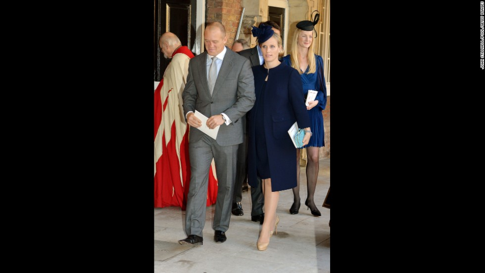 Godparent Zara Philips and husband Mike Tindall leave the palace.