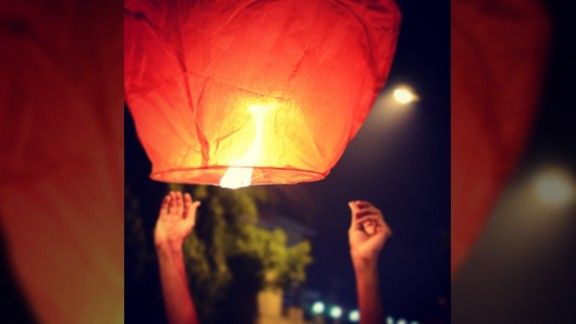 """This photo was taken during Diwali in 2011 when 17-year-old Kapil Gurnani and his brother decided to ditch the fire crackers for lanterns. """"My brother said that this is a way of enjoying Diwali with lights in a more peaceful way. We were up till late in the night lighting them. The lanterns kept flying in the air for hours, it was a very beautiful sight,"""" said the student from Silvassa, in western India."""
