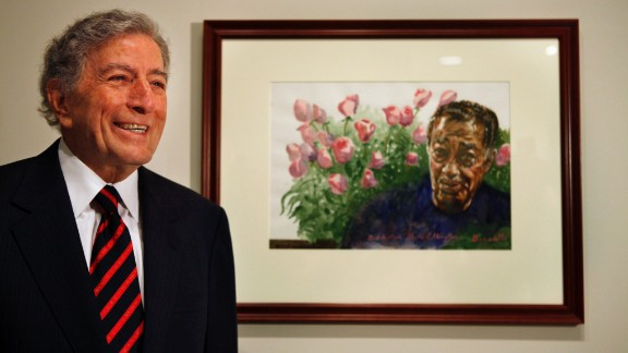 """Before he was a singer, Tony Bennett was a painter. He still is, and a successful one, too: His paintings sell for $10,000 or more. """"When I'm not painting, I often go up to the Metropolitan Museum of Art on Fifth Avenue for inspiration, to see how the greats solved problems,"""" he wrote in The Wall Street Journal. Here, Bennett presents a watercolor painting he did of Duke Ellington to the National Portrait Gallery in Washington in 2009."""
