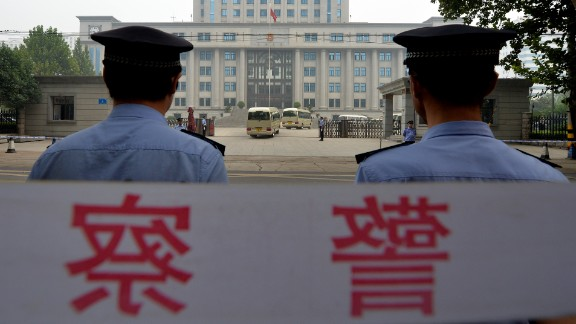 Police stand guard outside the court where disgraced politician Bo Xilai was sentenced to life in prison in September.