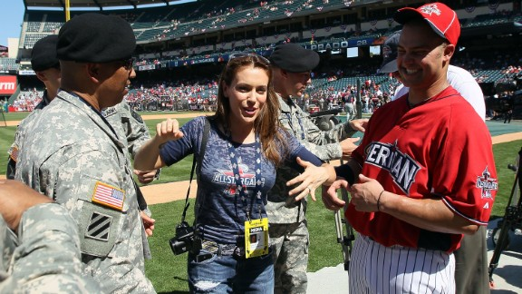 """Alyssa Milano is a huge baseball fan and doesn't mind if everybody knows. She's written a book about her love for the sport, """"Safe at Home,"""" and has contributed columns and interviews to variety of media."""