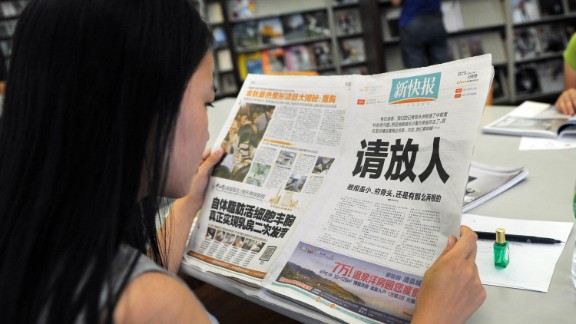 China's New Express newspaper made a bold front-page plea for the release of one of its reporters. Days later, the reporter made a taped confession.