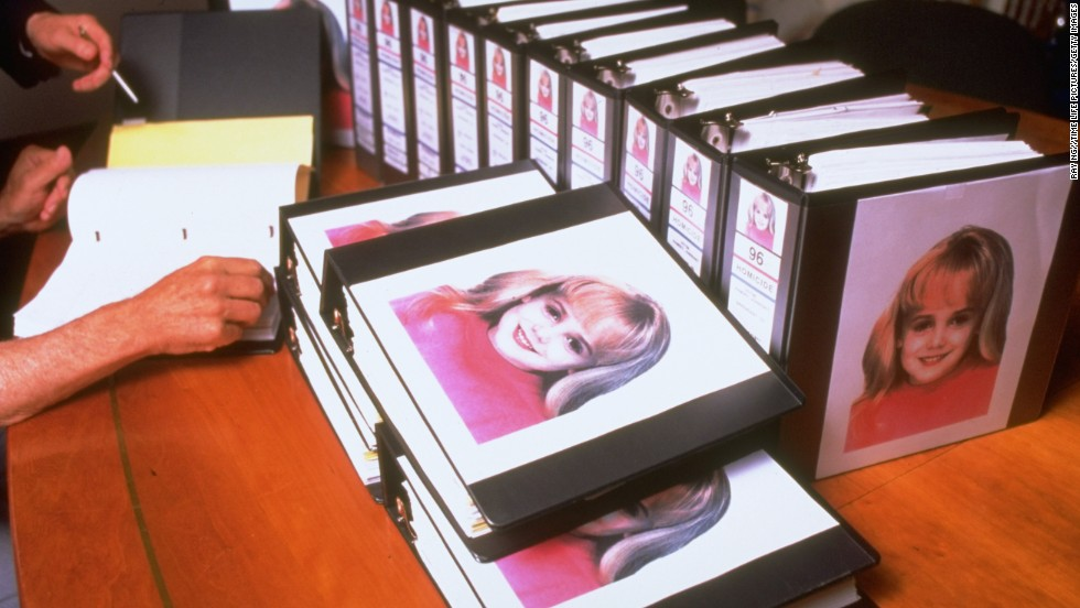 Binders were crammed with investigators' reports in the JonBenet case. Reports revealed that her skull had been fractured and the ransom note came from a notepad from the Ramsey's home.