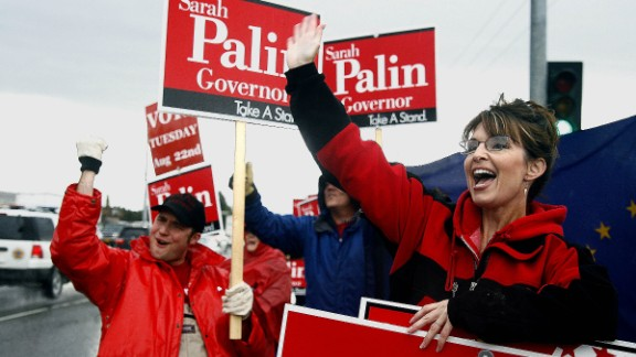 Palin stands in the rain in Anchorage in August 2006 as she campaigns for the Republican gubernatorial nomination. Palin defeated incumbent Frank Murkowski and former state legislator John Binkley.