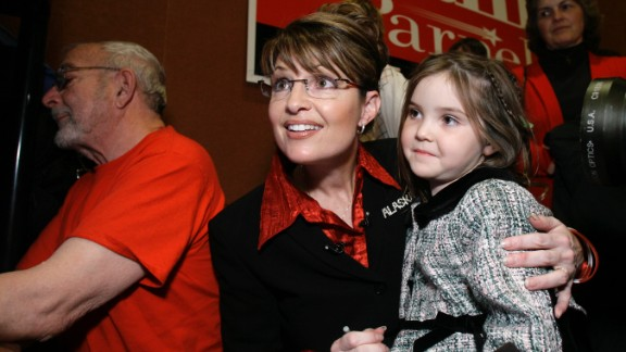 Palin holds her daughter Piper as she watches results on election night in November 2006. The former mayor of Wasilla became Alaska