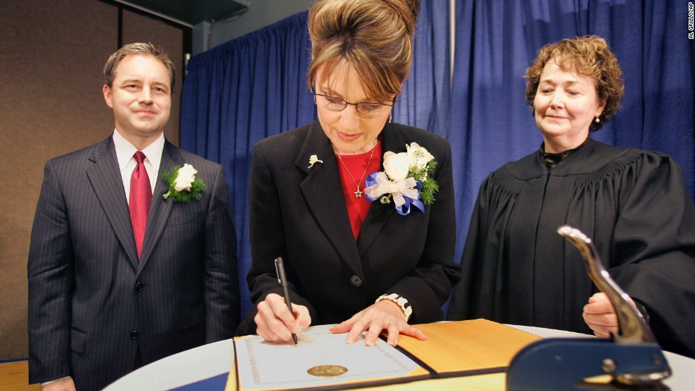 Palin signs her oath of office document as Lt. Gov. Sean Parnell, left, and Superior Court Judge Niesje Steinkruger look on after her swearing-in ceremony in Fairbanks, Alaska, in December 2006.