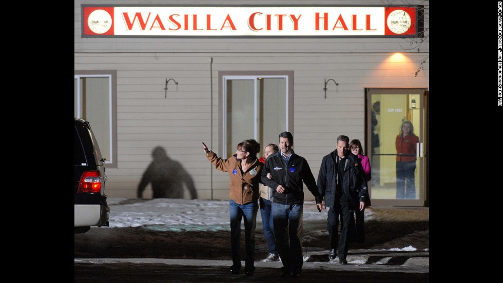 Palin and her husband leave City Hall after she voted in her hometown of Wasilla, Alaska, in November 2008. The Palins then flew to Arizona to join McCain.