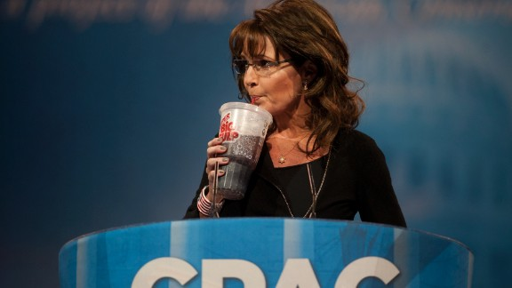 "Palin drinks a ""Big Gulp"" soda during the Conservative Political Action Conference in March 2013. She was mocking New York Mayor Michael Bloomberg"