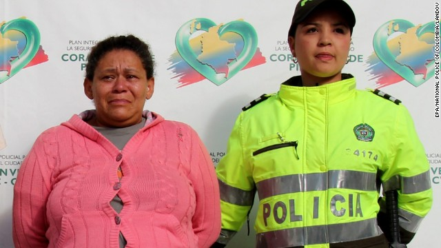 Image #: 25029848    epa03921433 Handout photo released by the National Police of Colombia on, 23 October 2013, showing 45 year old Colombian Margarita Zapata Moreno (L), after her detention accused of selling the virginity of 12 of her daughters. The complaint was made by her 14 year old daughter who is pregnant of 51 year old Tito Cornelio Daza, who was also detained along with Margarita Zapata Moreno. According to the investigations made by the Judicial Police, the mother allegedly sold her daughters' virginity when they turned 12, for up to 200 dollars (400.000 pesos).  EPA/National Police of Colombia /LANDOV