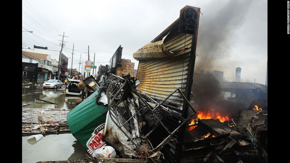 A fire burns near destroyed homes and businesses in the Rockaway section of Queens, New York, on October 30, 2012.