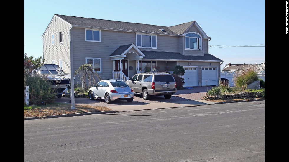 Cars sit parked in a driveway on West Lido Boulevard on October 22.