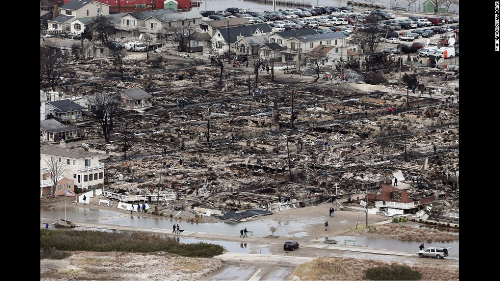 The remains of burned homes are surrounded by water in the Breezy Point neighborhood of Queens on October 31, 2012.