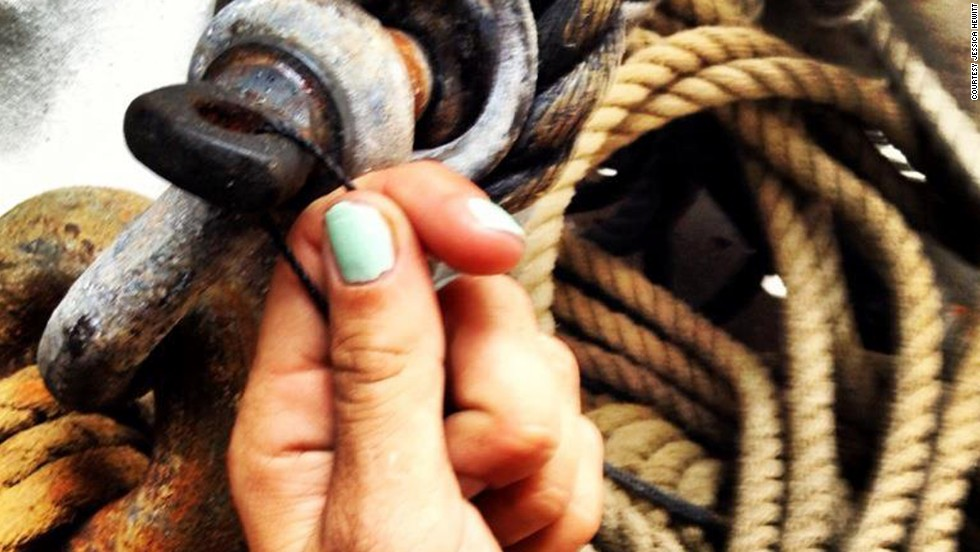 "Hewitt nearly drowned because her tether to a shipmate got caught on sinking debris. She posted this Facebook photo of herself holding twine and ship's rigging. She captioned it, ""Strong like seine twine."" <br /><br />""It's hard when people say cruel things,"" Hewitt said, ""like 'oh, Bounty, those reckless people' or 'they're loving the attention they get.' They don't see the side like when I had to interrupt my job conducting boat tours to go cry in a Porta-Potty."""