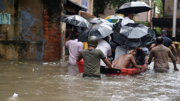 Indian police officials pull a boat through water-logged streets as they ferry residents to a safer place in Kolkata on October 26.