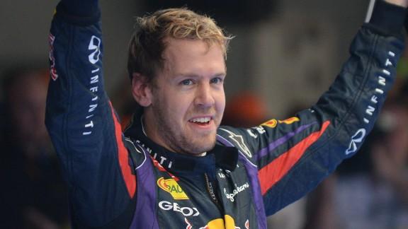 Sebastian Vettel celebrates his Indian Grand Prix victory to clinch his fourth straight F1 world title.