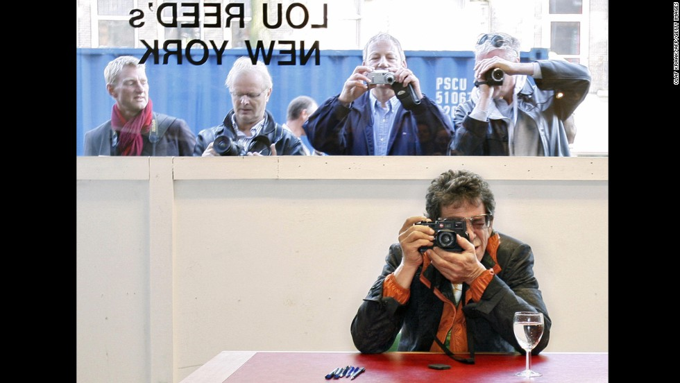 Reed takes a picture during the opening of his exhibition Lou Reed's New York in Serieuze Zaken Studioos, in Amsterdam on October 10, 2007.