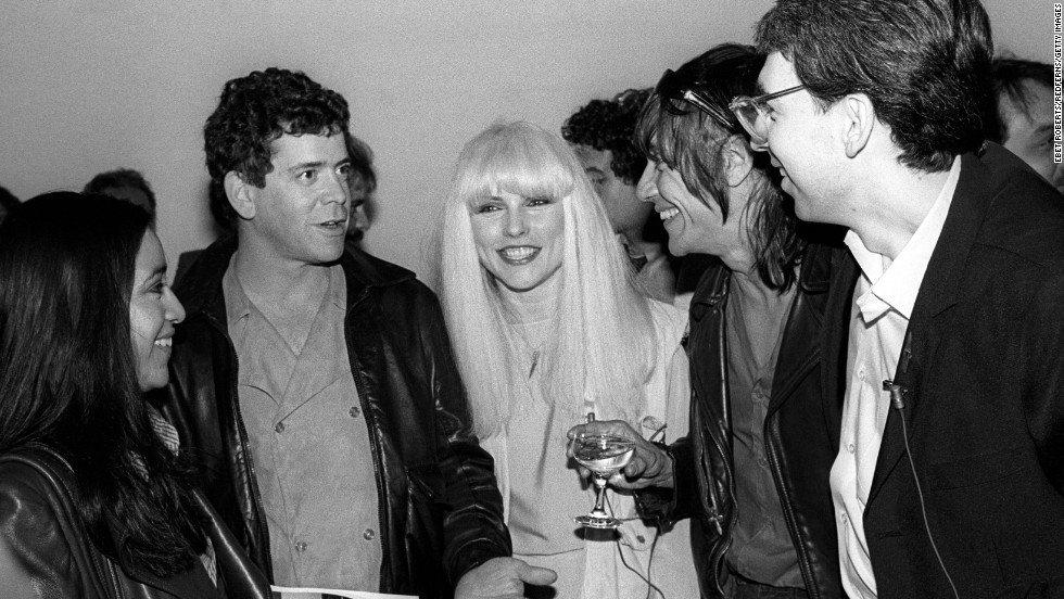 Reed, Debbie Harry of Blondie, center, and Iggy Pop, second from right, attend a party for a book on Blondie in New York on May 4, 1982.