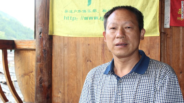 Tang Cheng, a Miao village chief, says tourists don't appreciate his culture