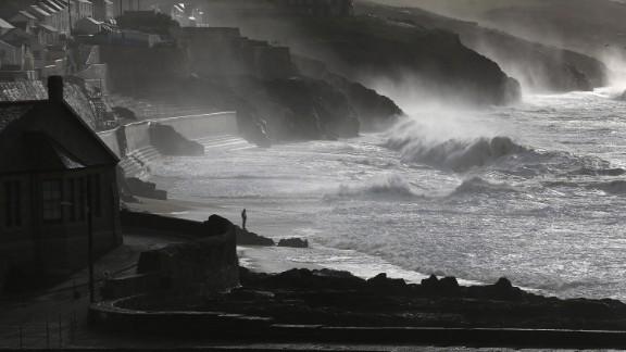 Large waves break along the coast in Porthleven, England, on Monday.