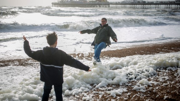 Father and son play on the beach in Brighton, England, on Sunday.