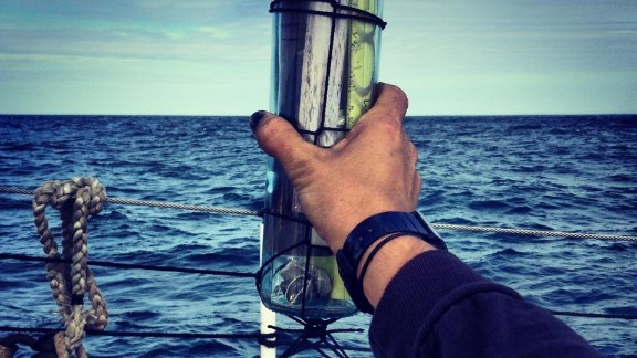 """The message bottle, weighted with an iron shackle, is """"the only way the message would get to them,"""" Hewitt said. During the ceremony, Hewitt read aloud from sailing poems by Henry Longfellow and Walt Whitman"""