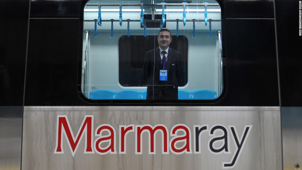 "A Turkish train driver stands at a Marmaray station ahead of the inauguration ceremony. The Marmaray name combines the Sea of Marmara with ""ray,"" which means rail in Turkish."