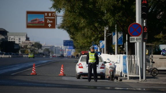 A policeman stands on Chang'an avenue before Tiananmen in Beijing on October 29, 2013. A fatal car crash in Tiananmen Square may have links to China's restive far western region of Xinjiang, state-run media said on October 29, a day after the high-profile incident. AFP PHOTO / Ed Jones (Photo credit should read Ed Jones/AFP/Getty Images)